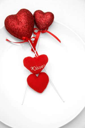 Glitter coated hearts on sticks and heart-shaped cushions photo