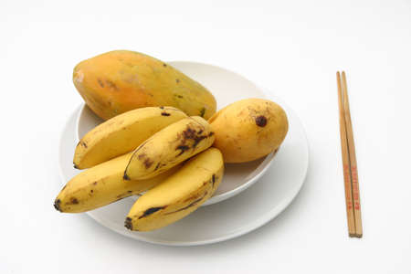 Tropical fruit served on white ceramics photo
