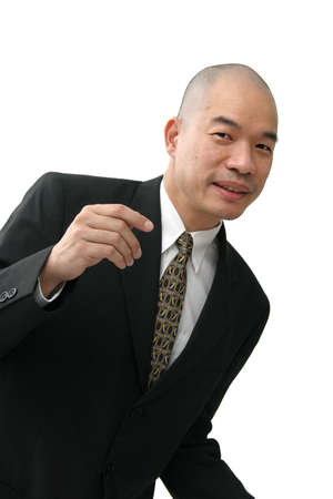 hold up: Oriental man in business suit leaning forward pretending to hold up something