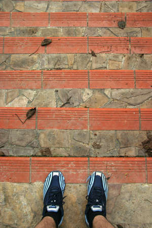 Person in sports shoes ready to go down some park steps Stock Photo - 364281