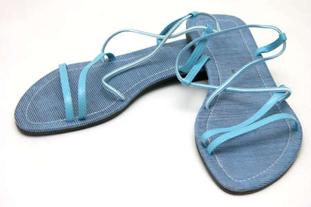 strapped: A pair of size eight blue ladies sandals on white background
