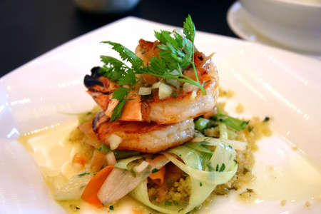 nourishment: Saut�ed king prawns with cous cous wrapped in springs of shallots and carrot slices