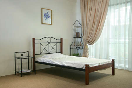 iron curtain: Single bed wooden and steel bedroom set Stock Photo