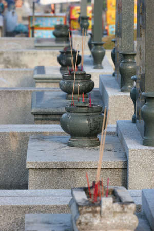 ancestors: Headstones and joss-stick urns in a typical Chinese cemetery