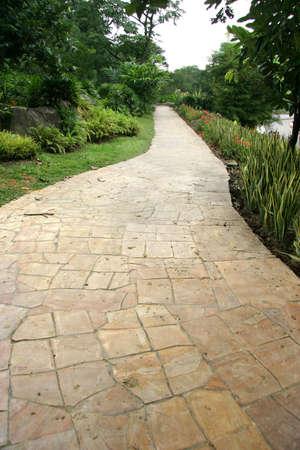 slightly: Slightly winding stone park pavement Stock Photo