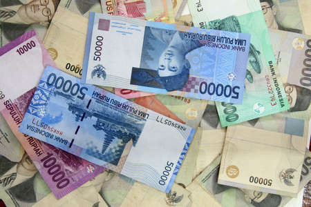 scattered: One million in Indonesian currency scattered about Stock Photo