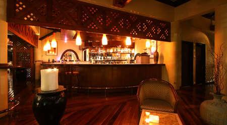 lounge chair: Dim lake-side bar at a Kuala Lumpur resort hotel