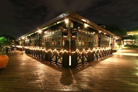 bar stools: Night time on a verandah at a lake-side bar at a Kuala Lumpur resort hotel