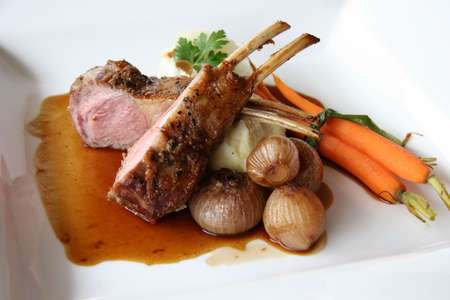 Rack of lamb with pickled poached onions, grapefruit and  carrots photo