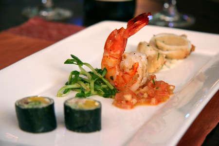 good cholesterol: King prawns & sushi plate at wine dinner Stock Photo