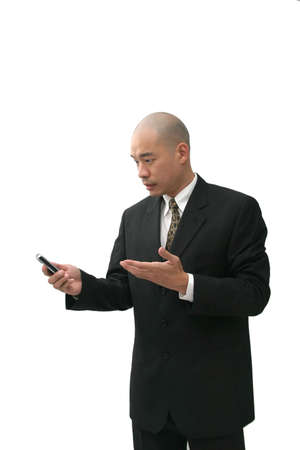 Oriental man in suit on cell phone looking puzzled, angry  or annoyed. Stock Photo - 509126