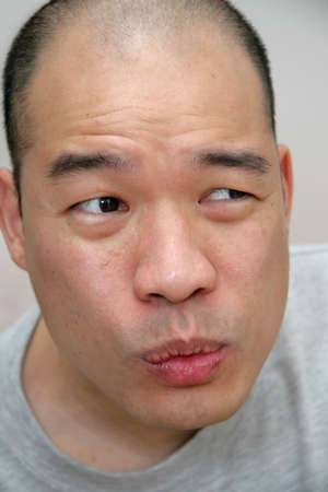 countenance: Funny expression on face of Oriental Chinese person