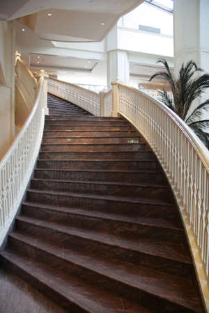 Grand curved staircase photo