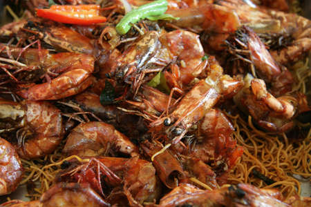 assam: Large tiger prawns cooked in a dry assam jawa style Stock Photo