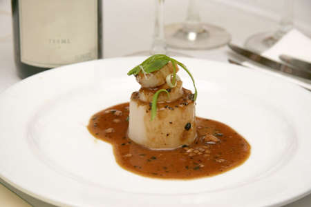 scallions: Scallop in brown mushroom sauce topped with freshly cooked scallions