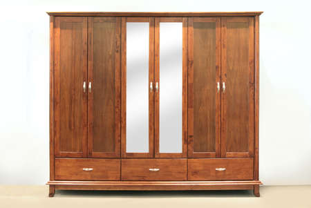 roomy: Large chestnut brown, rubber-wood, six door wardrobe with mirrors Stock Photo