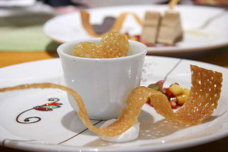 piped: Green Tea parfait served in a small cup with shaped sugar and glucose brittle
