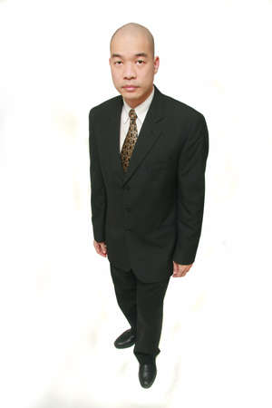 slits: High angled wide angle shot of a Chinese Malaysian male in business suit Stock Photo