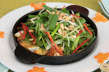 sizzle: Hot-plate sizzled fish with aromatic herb vegetables and baked crackers
