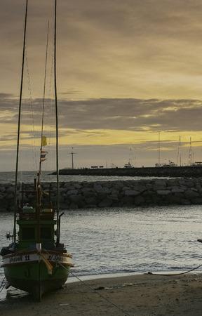 slipway: Fishing boat on the beach Editorial
