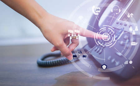 close up employee call center woman hand point to press button number on telephone office desk with virtual communication technology concept Archivio Fotografico