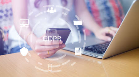 close up asian working woman using smartphone mobile and laptop at home office with virtual interface of GDPR (General Data Protection Regulation ) , privacy personal data concept Stockfoto