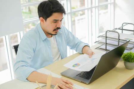 close up adult middle eastern man reading company's profit statistics report with stress emotion during work at home for healthy lifestyle concept