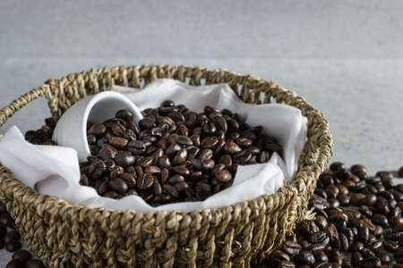 Coffee bean in basket on the stone table. Stock Photo