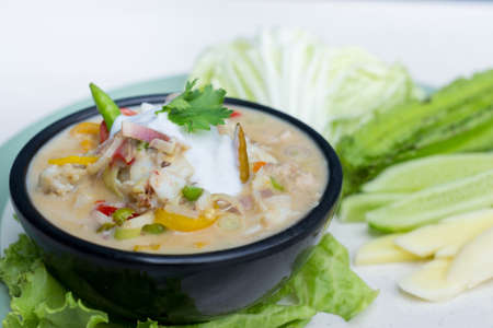 Crab dip with coconut milk and vegetables in bowl. Stock Photo
