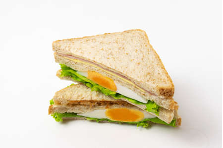 Homemade sandwich or toast wheat bread with lettuce and ham isolate on white background. Reklamní fotografie