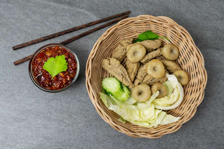 Meatballs with spicy sauce in basket on table. Reklamní fotografie