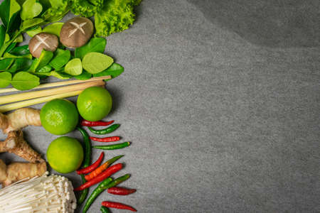 Vegetables and spices cooking to spicy soup on tile table. Reklamní fotografie
