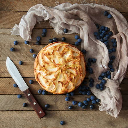 blueberry pie: Delicious blueberry pie on a wooden table