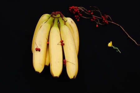 banana peel: Bunch of bananas on black background