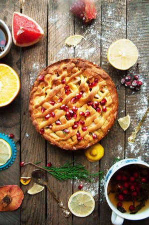 Apple pie on vintage wooden background texture. Top view. Homemade apple pie, apples on the wooden table. Rustic food style. Stock Photo