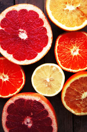 Fruit in a cut closeup, grapefruit, orange, lemon, tangerine, fruit background. rustic food. fruit. Fresh fruits.Mixed fruits background.Healthy eating, dieting, love fruits.