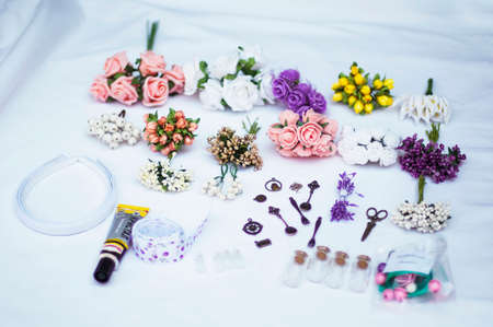 beaty: Hoop from flowers, wreath with colored flowers. Handmade flowers wreath on white. Accessory. Artificial flowers. Hair accessories. Beauty. Fashion. Decoration for the head. Wreath hair.