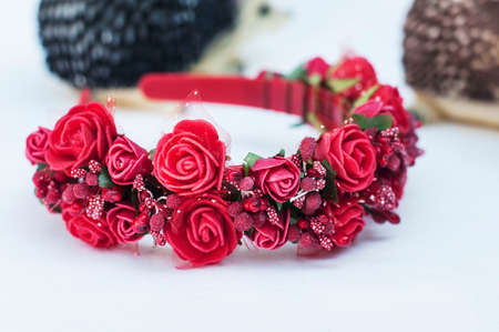 artificial hair: Hoop from flowers, wreath with colored flowers. Handmade flowers wreath on white. Accessory. Artificial flowers. Hair accessories. Beauty. Fashion. Decoration for the head. Wreath hair.