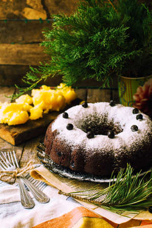 cake pick: Delicious vegan chocolate cake. Chocolate cake with marzipan and bluepberries. Chocolate cupcake. Delicious  chocolate cupcakes with spring flowers. Rustic style.