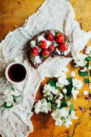 strawberry tart, strawberry shortcake, strawberry jam. serving homemade strawberry cake or pie on wooden rustic table. Strawberry tart on wooden tray, on rustic wooden background Stock Photo