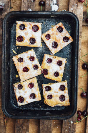 cherry pie: Homemade cherry cake ready to be eaten. Female hands making a cherry pie. Homemade Cherry pie.