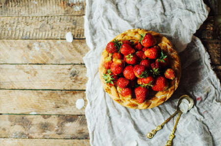 flaky: Homemade cherry and strawberry  pie on rustic background. Delicious Homemade Cherry Pie with a Flaky Crust. Rustic dark style. decorated with roses and jasmine flowers. Dessert for the family