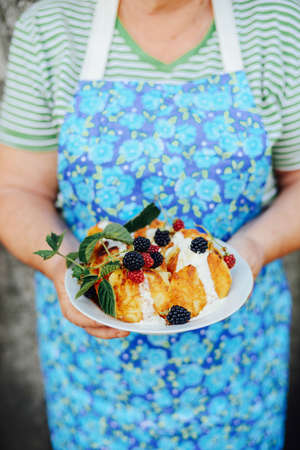 Pancakes with bluberries. Homemade pancakes with fruit. Delicious pancakes stacked with  blueberries. Homemade blueberry Dutch baby pancake. Stock Photo