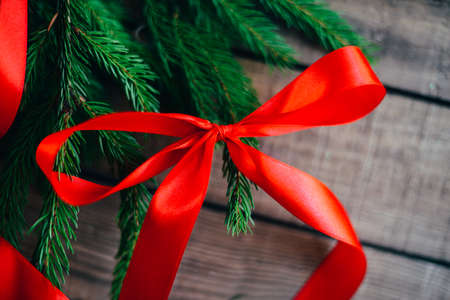 extensive: Extensive series of holiday shots with a variety of props and backgrounds. Lots of copyspace for ads. Christmas presents on wooden table. A couple of gifts wrapped in Christmas themed wrapping paper.