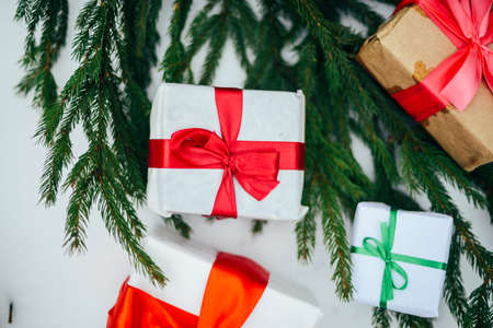 Extensive series of holiday shots with a variety of props and backgrounds. Lots of copyspace for ads. Christmas presents on wooden table. A couple of gifts wrapped in Christmas themed wrapping paper.