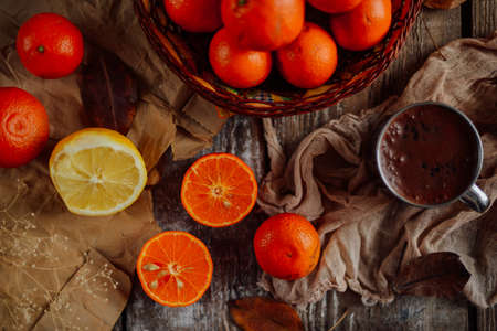 clementines: Basket of Tangerines on a wooden table.  Delicious and beautiful Tangerines.  Citrus background.  Mandarins Tangerine Closeup. Rustic style