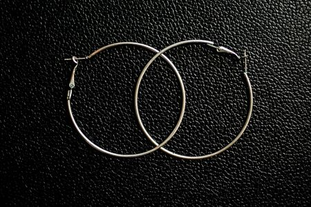 silver hoops with black leather bottom