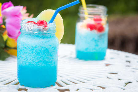 Blue cocktail drink in mason style jars