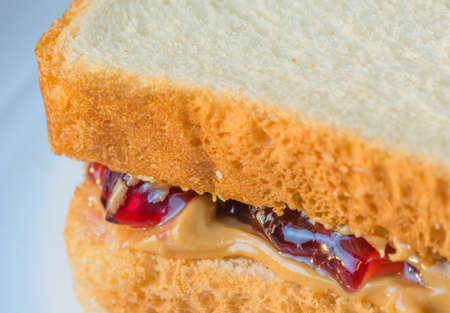 peanut butter and jelly: Macro close up of corner of peanut butter jelly sandwich