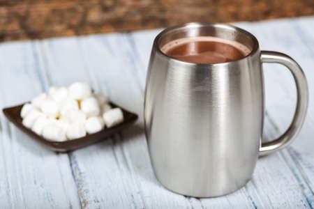 steel  milk: Hot Chocolate in a stainless silver mug Stock Photo
